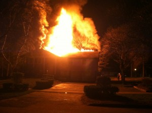 A house fire flares in the night