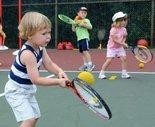 Children during tennis lesson